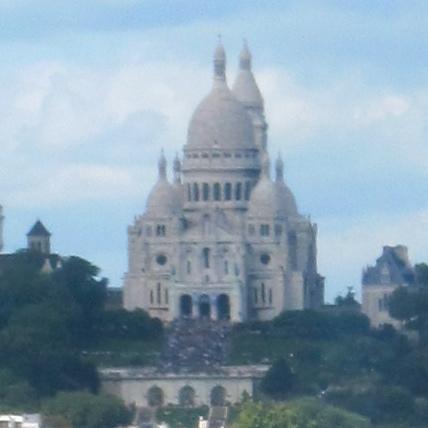 People on the steps of Sacre Coeur